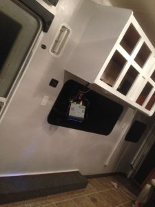 Toy Hauler Travel Trailer Renovations - Base coat on walls and cabinet bases with high gloss white