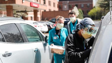 ER technicians test patients for Covid-19 outside of the emergency entrance of Beaumont Hospital in Grosse Pointe, Michigan, on Thursday.