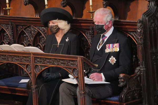 Camilla, Duchess of Cornwall and Prince Charles sit during the funeral service.