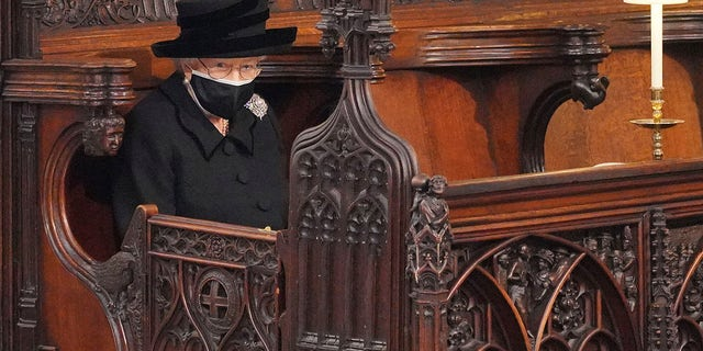 Britain's Queen Elizabeth II looks on as she sits alone in St. George's Chapel during the funeral of Prince Philip.