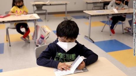 A first-grader works on an English exercise on the first day of class in Los Angeles on April 13, 2021.
