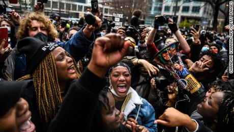 People celebrate outside the Hennepin County Government Center in Minneapolis on April 20, 2021, as the verdict is announced in the trial of former police officer Derek Chauvin.