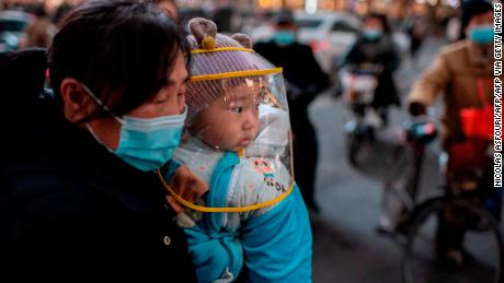 A woman and her baby seen in the Chinese city of Wuhan in January 2021.