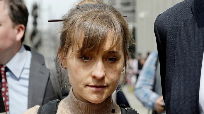 In this Dec. 6, 2018, file photo, television actress Allison Mack leaves federal court in New York. Prosecutors say the purported self-help group called NXIVM formed a secret society of women who had unwanted sex with guru Keith Raniere. Raniere and three co-defendants including heiress Clare Bronfman and TV actress Allison Mack have pleaded not guilty to conspiracy and other charges in the sex-trafficking case.