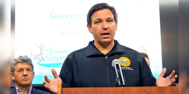 Florida Gov. Ron DeSantis gestures during a news conference Sunday, April 4, 2021, at the Manatee County Emergency Management office in Palmetto, Fla. (Associated Press)