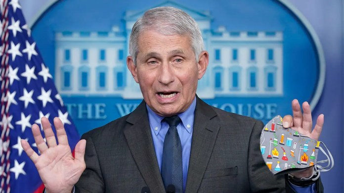 "Dr. Anthony Fauci, director of the National Institute of Allergy and Infectious Diseases, speaks during a press briefing at the White House, Tuesday, April 13, 2021, in Washington. Fauci said Sunday that the risk of catching the coronavirus outdoors is ""really quite<br>