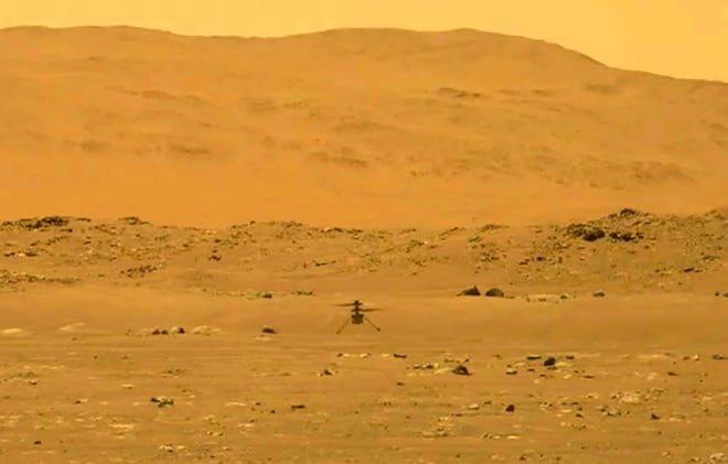 The Perseverance rover photographed the Mars helicopter Ingenuity as it landed on the Martian surface after its historic first flight on April 19.
