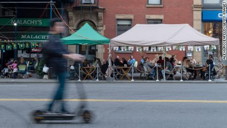 Diners eat out in New York City, April 10. With the spread of more contagious variants, know that dining outdoors is lower risk than eating inside. Be sure to sit with your household. Takeout is ideal, Dr. Wen said.