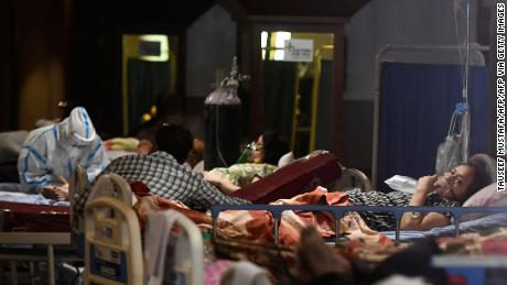 Covid-19 coronavirus patients rest inside a banquet hall temporarily converted into a Covid-19 coronavirus ward in New Delhi on April 29, 2021.