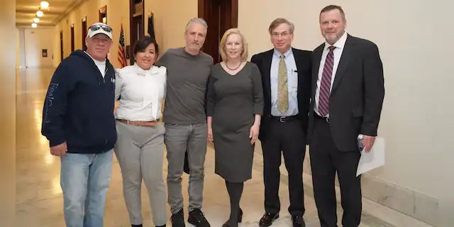 Jon Stewart (center) has been working with Senator Kirsten Gillibrand (D-NY, center) along with advocates John Feal (left) and Rosie Torres (left), founder of Burn Pits 360.