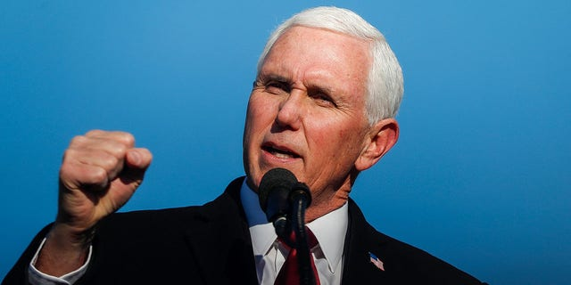 Former Vice President Mike Pence and his family join him as he gives remarks to a small crowd on Wednesday, Jan. 20, 2021 at Columbus Municipal Airport in Columbus, Ind.Ini 0120 Pence Vp