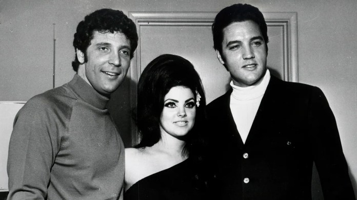 Elvis Presley (R) and Tom Jones pose for a portrait with Elvis' wife Priscilla Beaulieu Presley on April 7, 1968, in Las Vegas, Nevada.