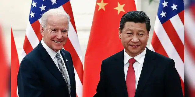 FILE - Chinese President Xi Jinping shakes hands with U.S. Vice President Biden inside the Great Hall of the People in Beijing December 4, 2013. REUTERS/Lintao Zhang/Pool