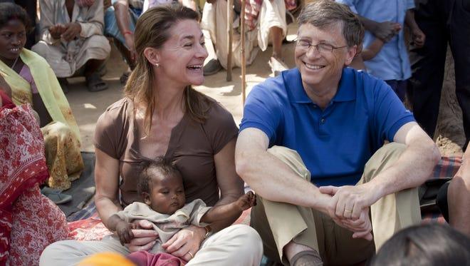 Bill and Melinda Gates meet with women in Jamsaut village in Bihar, India.