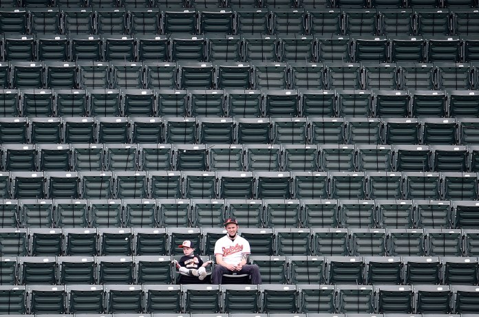 Fans look on during the second inning of the game between the Baltimore Orioles and the New York Yankees at Oriole Park at Camden Yards on April 29, in Baltimore.