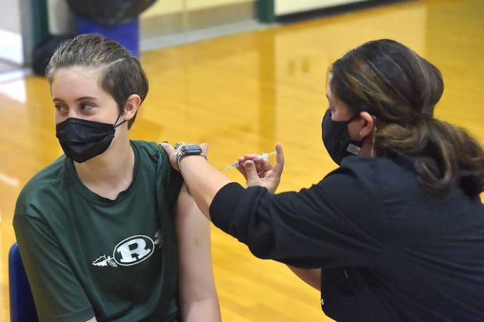 Students ages 16 to 18 and parents are given the Pfizer-BioNTech COVID-19 vaccine at Ridley High School in Folsom, Pennsylvan