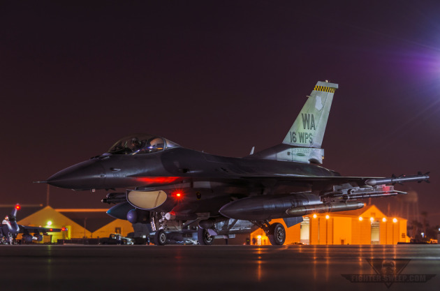 A Lockheed-Martin Block 52 F-16CJ from the 16th Weapons Squadron prepares to launch for a night sortie at Nellis AFB, NV
