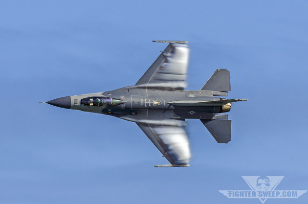 """Major Ryan """"Rider"""" Corrigan pilots a Block 50 F-16CJ through a high-speed, high-G turn during a demonstration of the Viper's supreme agility."""