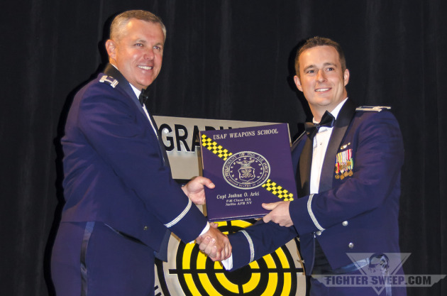 """Captain Joshua """"CATA"""" Arki receives his diploma from the United States Air Force Weapons School"""