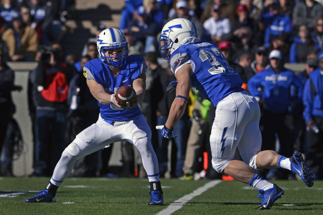 Air Force freshman quarterback Nate Romine hands off to senior running back Anthony LaCoste during the Air Force-Army football game at Falcon Stadium Nov. 2, 2013. LaCoste scored on 73- and 78-yard runs to lead the Falcons over the Black Knights, 42-28. (U.S. Air Force photo/Mike Kaplan)