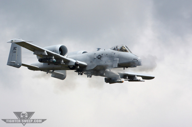 A Republic A-10C Thunderbolt II delivers 30mm rounds from the GAU-8 cannon in its nose, decimating the intended target.