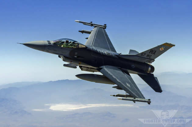 """Major Michael """"Double"""" Blauser pilots a Block 52 F-16CJ over the Nevada Test and Training Range during a training mission."""