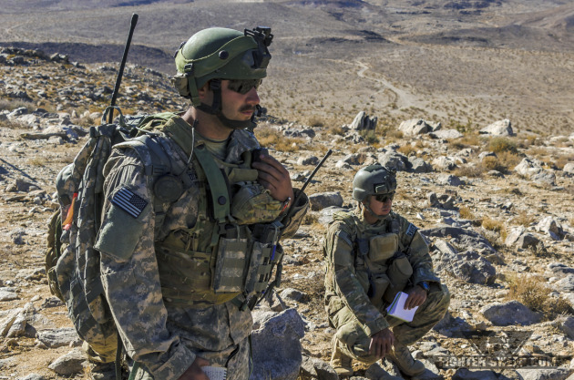 An Army Ground Liaison Officer (GLO) and Air Force JTAC listen to a pair of F-16s from the Alabama Air National Guard during a Close Air Support training mission at Fort Irwin, CA.