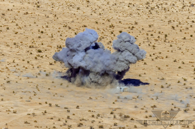 A 500-pound bomb impacts a structure at Fort Irwin, CA during a Green Flag-West exercise.