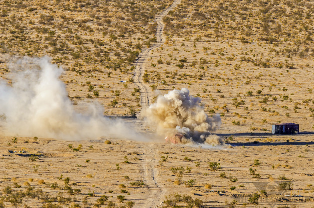 .50-caliber rounds mark a target building for orbiting A-10Cs to direct fire on.