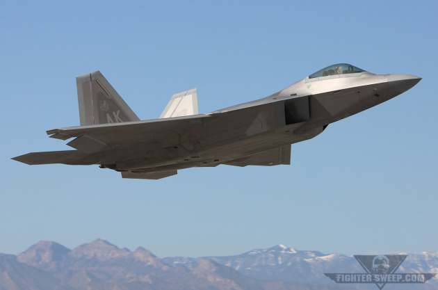 An Alaska-based Lockheed-Martin F-22A Raptor takes to the skies from Nellis AFB for a training exercise.