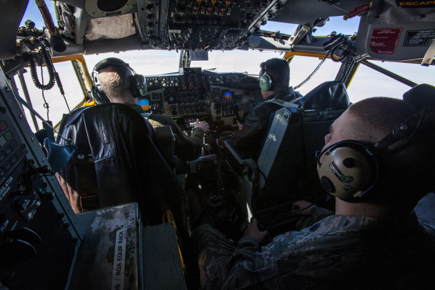 A cadet from Detachment 750, Air Force ROTC, St. Joseph's University, observes the aircrew onboard a 108th Wing KC-135 Stratotanker with the New Jersey Air National Guard, assigned to Joint Base McGuire Dix-Lakehurst, N.J., on a refueling mission April 2, 2014. The orientation flight offers the 25 Air Force ROTC cadets an opportunity to observe the pilots and aircrew perform their jobs in a real world environment. (U.S. Air National Guard photo by Master Sgt. Mark C. Olsen/Released)