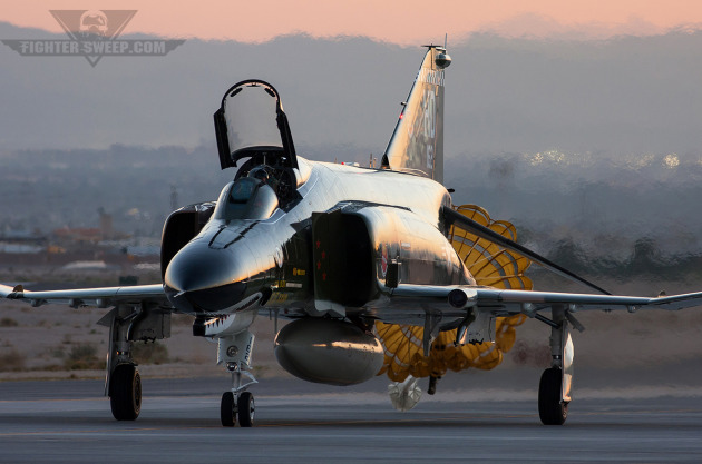 A McDonnell Douglas QF-4E taxis back to park after landing at Nellis AFB.