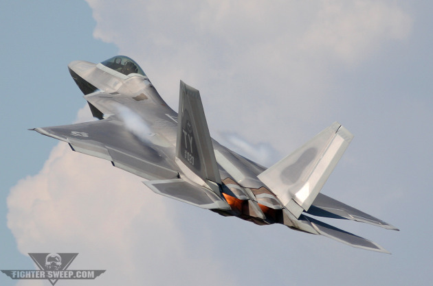 "A Lockheed-Martin F-22A Raptor, flown by then-Major Shawn ""Rage"" Anger, departs Tyndall AFB in full afterburner during an airshow in 2006."