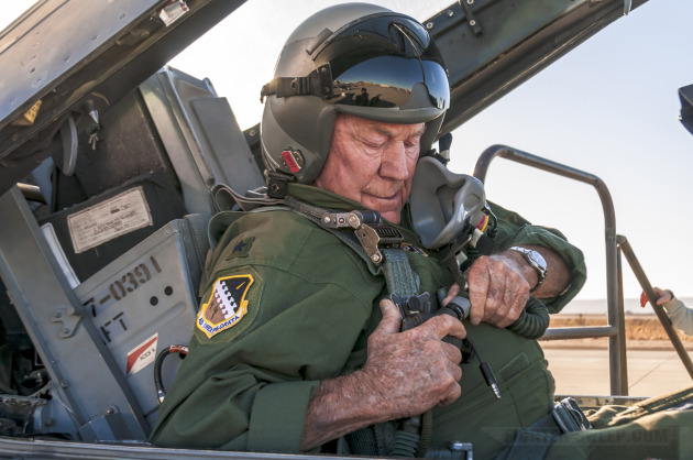 Brigadier General (Retired) Chuck Yeager straps into an F-16 in preparation for a supersonic flight at Edwards AFB in 2009.