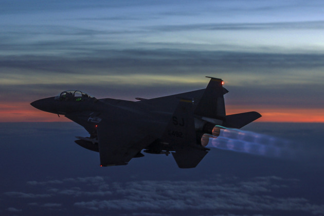 A Boeing F-15E Strike Eagle in full afterburner while engaging in contingency operations overseas.