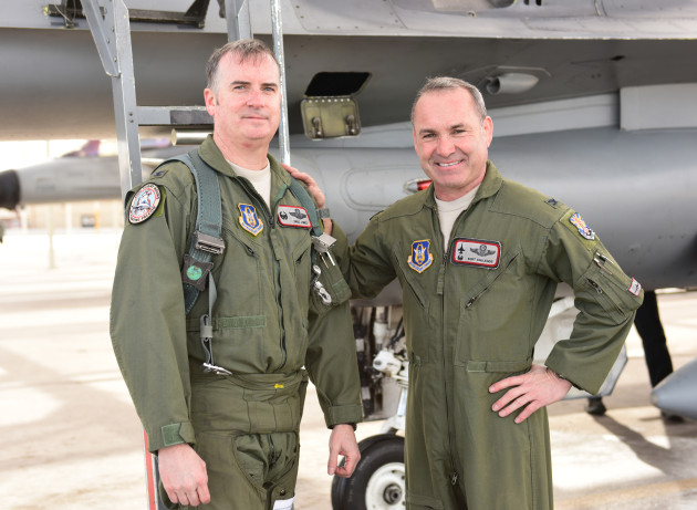 Col. Gregory Jones (right), 944th Operations Group commander, is congratulated by Col. Kurt Gallegos, 944th Fighter Wing commander, after completing 4000 hours of flying Jan. 8, 2015, at Luke Air Force Base, Ariz. Jones and Gallegos are two out of 42 pilots in the Air Force who have reached this milestone. (U.S. Air Force photo by Staff Sgt. Lausanne Kinder)