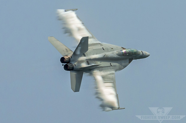 A Boeing F/A-18F Super Hornet departs the beach in spectacular fashion.
