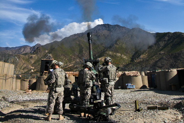 U.S. Army Soldiers assigned to Bravo Company, 2nd Battalion, 77th Field Artillery Regiment, 4th Brigade Combat Team, 4th Infantry Division, fire a 105 mm round with an M119 light-tow howitzer during live-fire training at Combat Outpost Monti in the Kunar province of Afghanistan, Dec. 2, 2009. (Courtesy of Flickr)