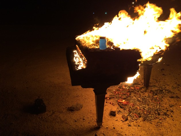 The 65 AGRS piano burns, along with the notorious jar of Kool-Aid.