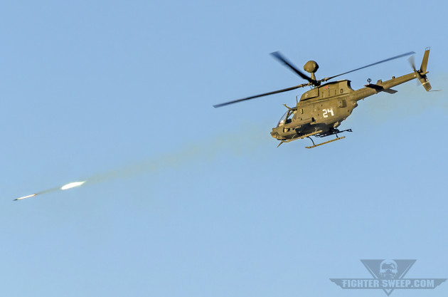 "An OH-58D Kiowa Warrior engages a target with a 2.75"" rocket."