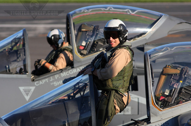 "A pair of VMA-223 ""Bulldogs"" pilots strap on their jets prior to departing on a local mission"