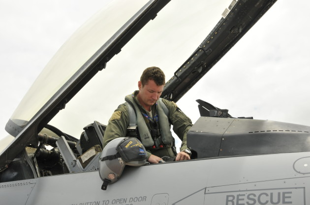 "The helmet riding ""Viper standard"" as the author settles into the cockpit."