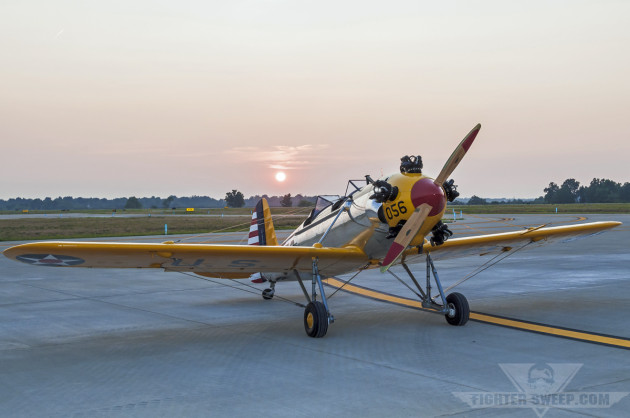 The author's PT-22 sits on the ramp at Bluegrass Airport in Lexington, Kentucky in front of the setting sun.