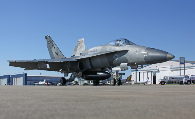 A Boeing F/A-18A+ Hornet from VFA-204 sits on the ramp.