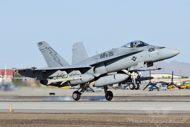 A Marine Hornet from VMFA-251 lands, carrying an AGM_88 HARM.