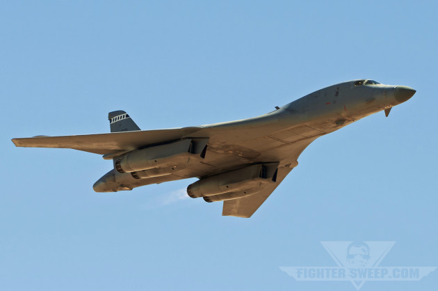 A B-1B from the 412 TW at Edwards AFB conducts a high-speed flyby during an airshow.