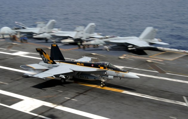 """130914-N-GC965-122 PACIFIC OCEAN (Sept. 14, 2013) An F/A-18E Super Hornet with the """"Eagles"""" of Strike Fighter Squadron (VFA) 115 makes an arrested landing on the flight deck of USS George Washington (CVN 73) during the Carrier Air Wing (CVW) 5 fly-on. George Washington and its embarked air wing, CVW 5, provide a combat-ready force that protects and defends the collective maritime interest of the U.S. and its allies and partners in the Indo-Asia-Pacific region. (U.S. Navy photo by Mass Communication Specialist 3rd Class Ramon G. Go/Released)"""