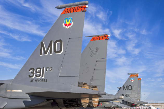 Two F-15Es from the 391 FS sit on the ramp under a beautiful fall sky.