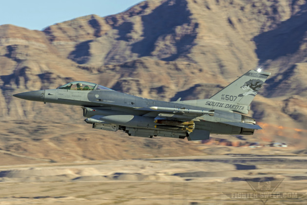 A Block 40 Lockheed-Martin F-16CM of the 175th Fighter Squadron, South Dakota Air National Guard, takes off from Nellis Air Force Base, Nevada with live bombs.