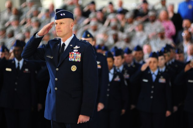 """U.S. Air Force Maj. Gen. James N. Post III, vice commander of Air Combat Command, and Airmen render salutes during the playing of the National Anthem during the ACC change of command ceremony at Langley Air Force Base, Va., Nov. 4, 2014. Gen. Herbert """"Hawk"""" Carlisle assumed command from Gen. Mike Hostage. (U.S. Air Force photo by Airman 1st Class Areca T. Wilson/Released)"""